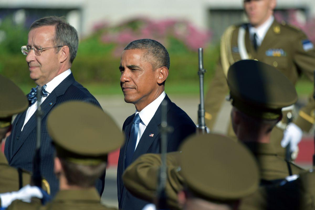 Estonian President Toomas Hendrik Ilves and US President Barack Obama inspect troops in Tallinn, Estonia, on September 3