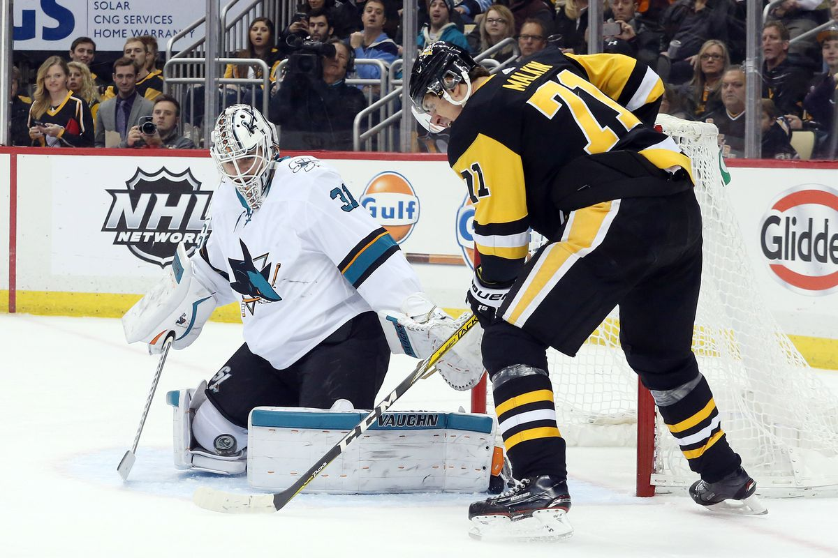 San Jose Sharks Goalie Martin Jones 31 Blocks A Shot By Pittsburgh Penguins Brian Dumoulin Left During The Second Period Of 4 Nhl Hockey