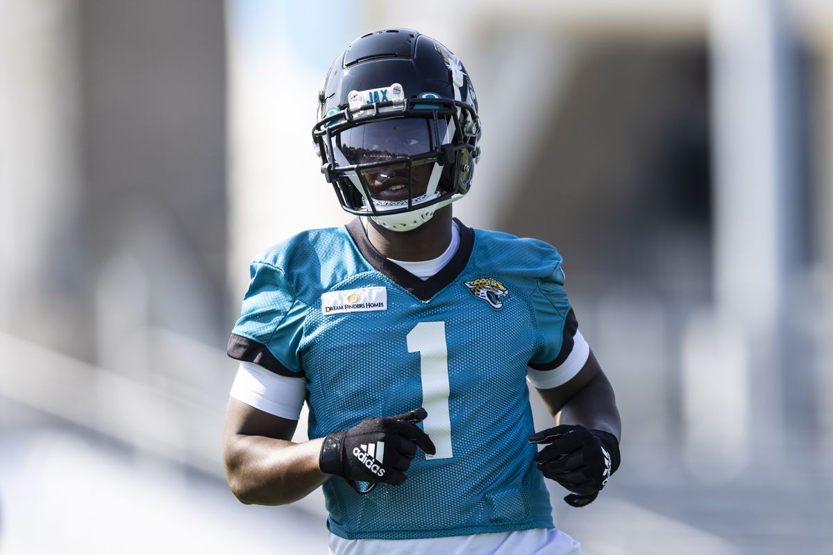 Travis Etienne Jr. #1 of the Jacksonville Jaguars looks on during training camp at TIAA Bank Field on July 28, 2021 in Jacksonville, Florida.