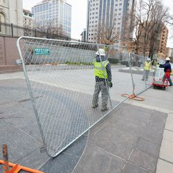 A fence is installed around the Salt Lake Temple as a major renovation project commences.