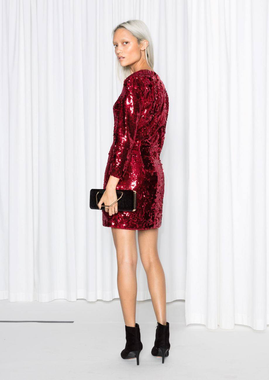 abf921766094a a woman with bleach blonde hair in a red sequin mini dress