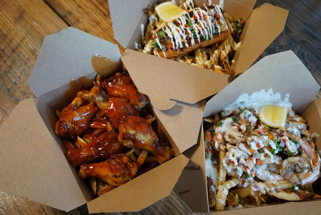 Jerk salmon frite, wing frite, and Caribbean shrimp frite, made at Friistyle.