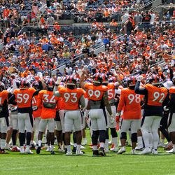 The team comes together before breaking into team drills.