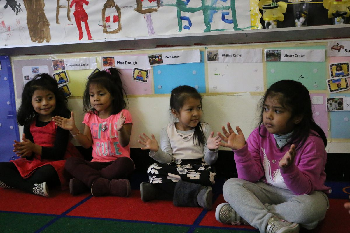 Students in Mabrouka Braktia's pre-K class clap their hands to a song. As a special education preschool teacher, Braktia estimates she could make about $20,000 more in a public school classroom.