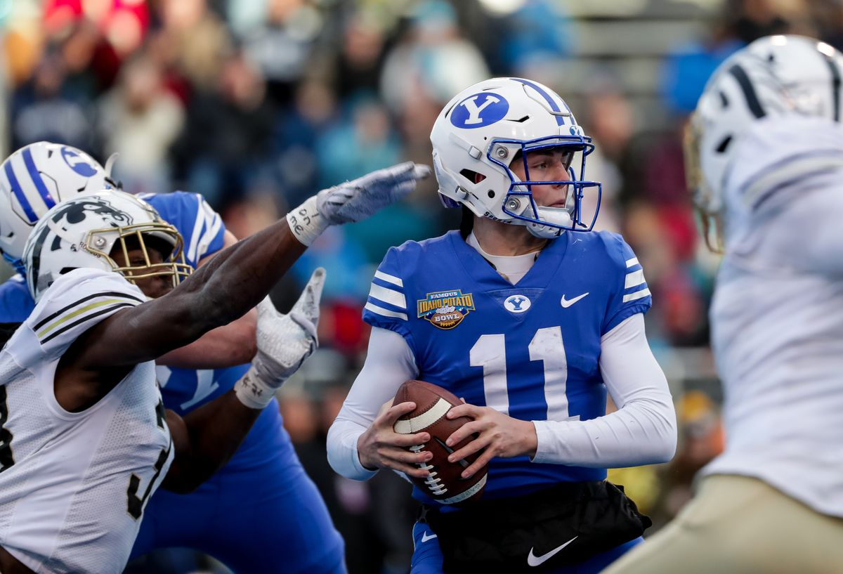 BYU quarterback Zach Wilson moves under pressure from the Western Michigan Broncos defense during the Famous Idaho Potato Bowl at Albertsons Stadium in Boise on Friday, Dec. 21, 2018.