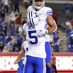 BYU wide receiver Dax Milne (5) celebrates his touchdown with Neil Pau'u during the first half of an NCAA college football game against Houston, Friday, Oct. 16, 2020, in Houston.