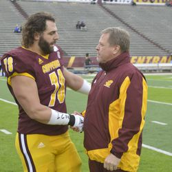 Clay Walderzak and Jim McElwian share a very business-like handshake during Senior Day ceremonies.