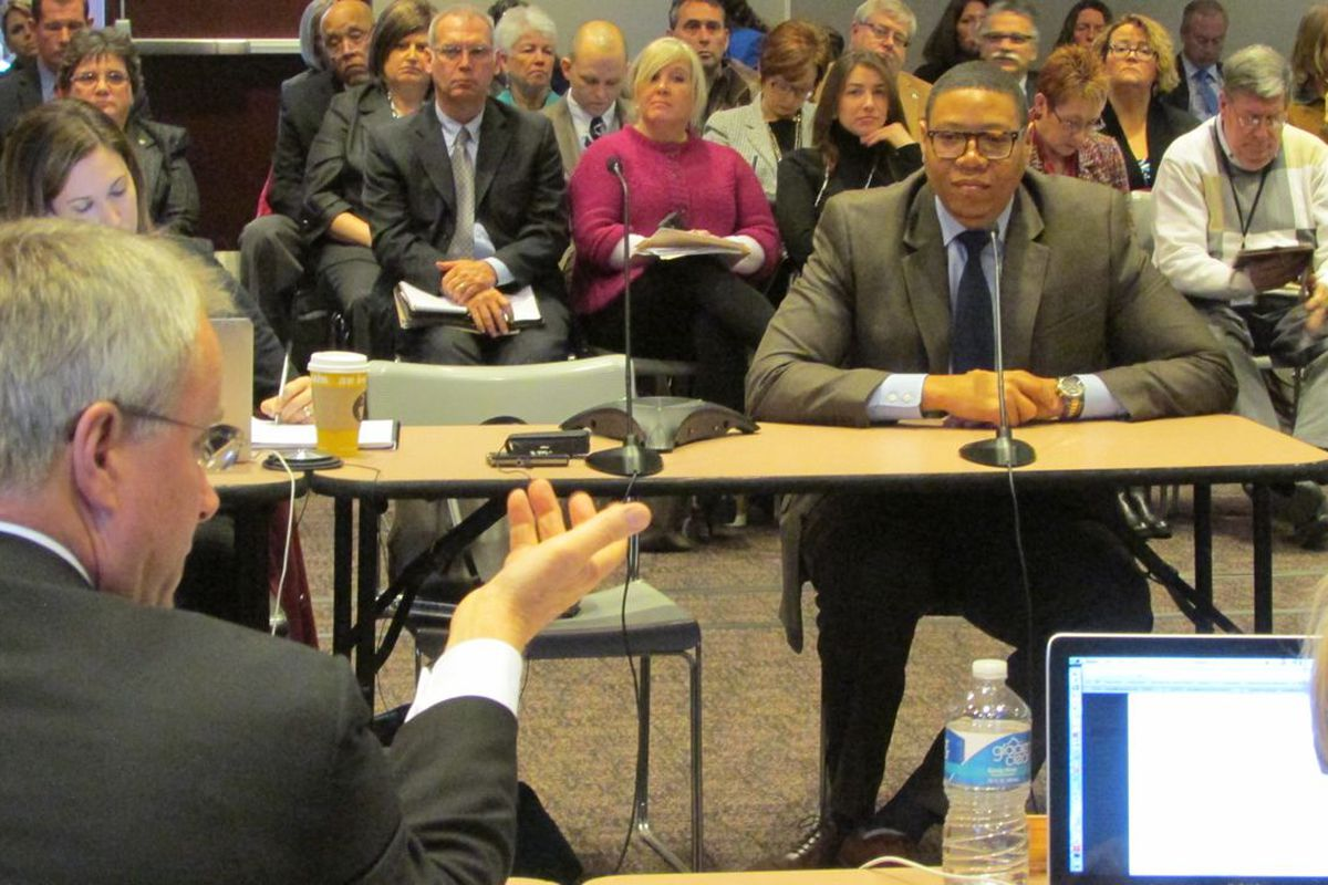 State Board of Education member Dan Elsener asks questions of  IPS Superintendent Lewis Ferebee at a board meeting last year.