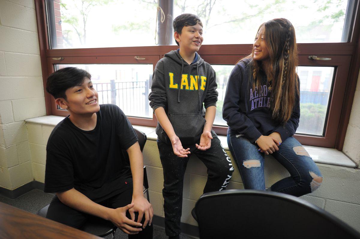Funston Elementary School eighth-graders Hugo Rabadan (from left), Diego Mata, and Alexandra Martinez
