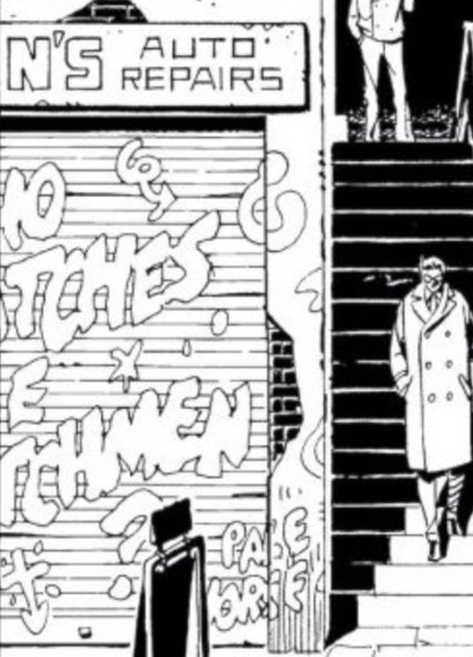 """Who watches the Watchmen"" appears as graffiti on a roll-down door on an auto repair shop in a panel of the comic ""Watchmen."""
