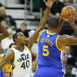 Utah's Jeremey Evans defends Warriors' Marreese Speights as they Utah Jazz and the Golden State Warriors play Tuesday, Oct. 8, 2013 in preseason action at Energy Solutions arena in Salt Lake City.