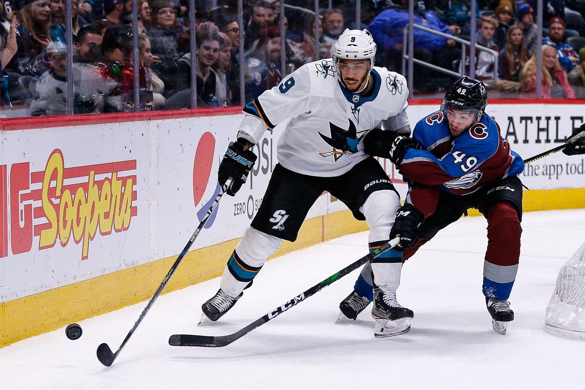 Jan 16, 2020; Denver, Colorado, USA; San Jose Sharks left wing Evander Kane (9) and Colorado Avalanche defenseman Samuel Girard (49) battle for the puck in the third period at the Pepsi Center.