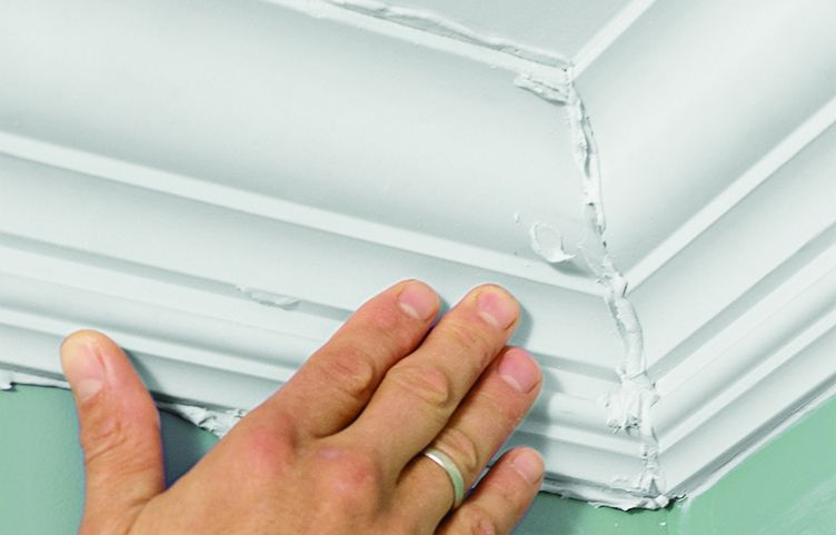 Man Pushes Mitered Ends Of Crown Molding Together