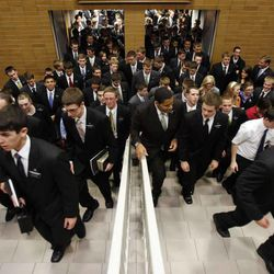 Missionaries enter the auditorium for a devotional at the Provo Missionary Training Center on March 8, 2011. Returned missionaries' attachment to the people they served likely influences their views on immigration.