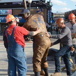 5:15 p.m. Ernie Banks statue on its feet -