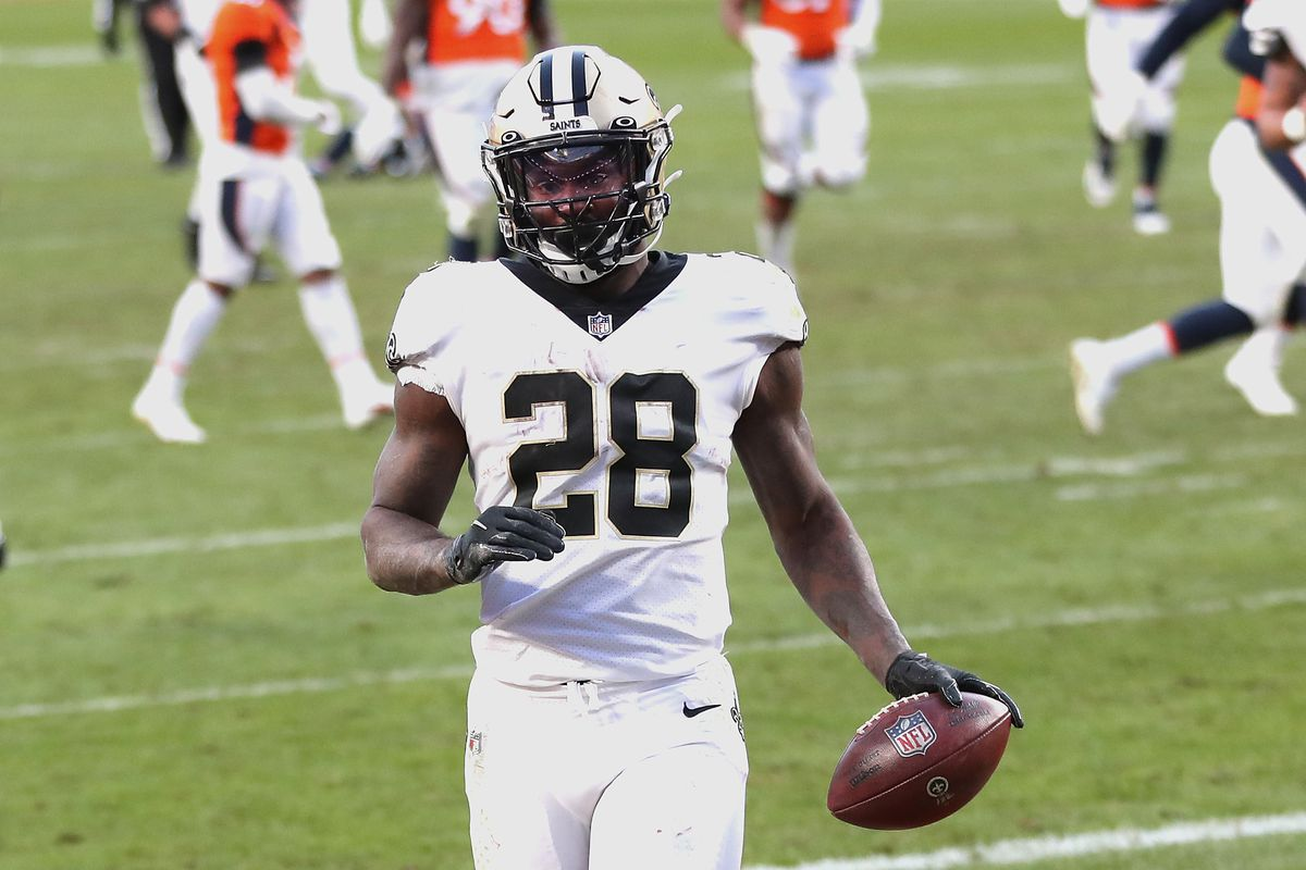 Latavius Murray #28 of the New Orleans Saints rushes for a 36 yard touchdown during the third quarter of a game against the Denver Broncos at Empower Field At Mile High on November 29, 2020 in Denver, Colorado.