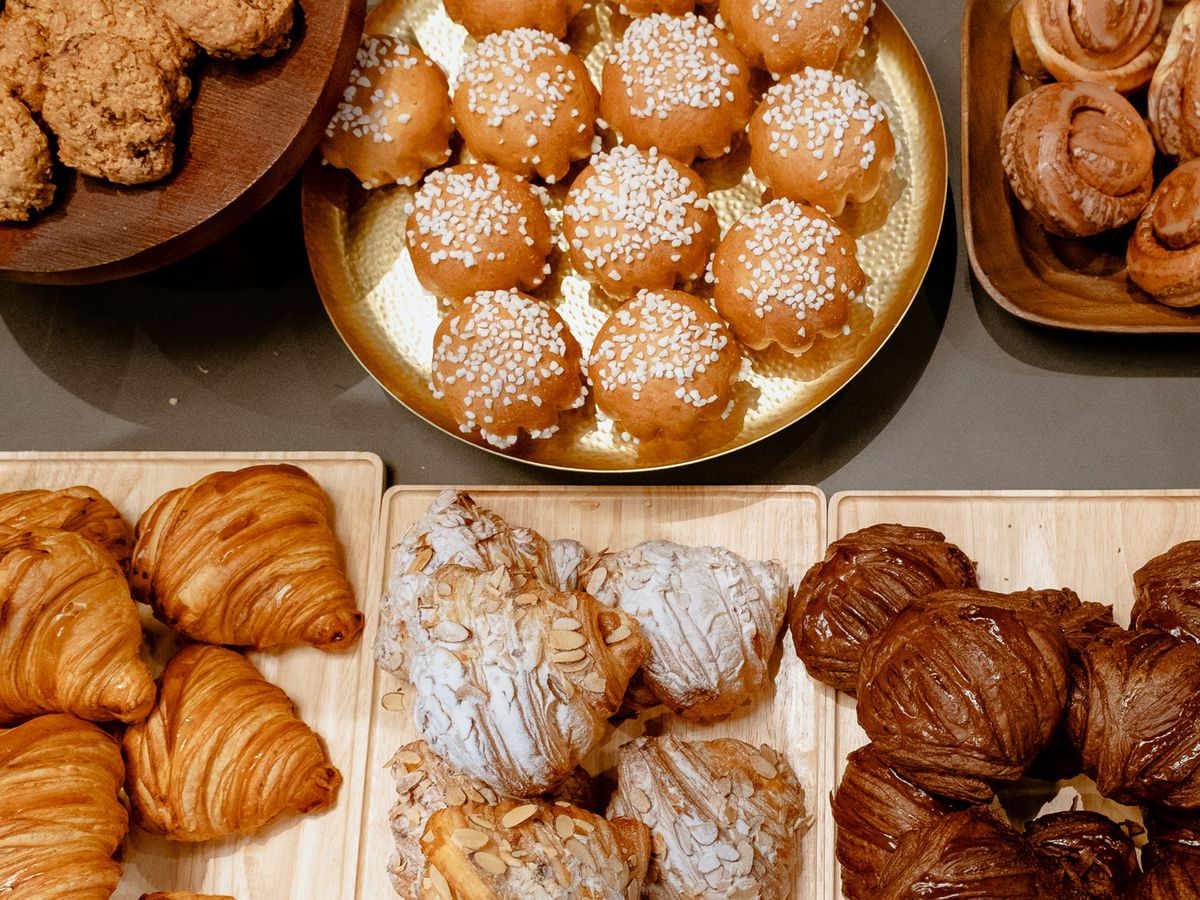 Overhead view of six different types of pastries, including croissants and more