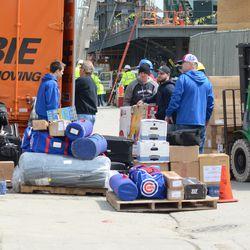 Flat screen TV coming off the Cubs gear truck -
