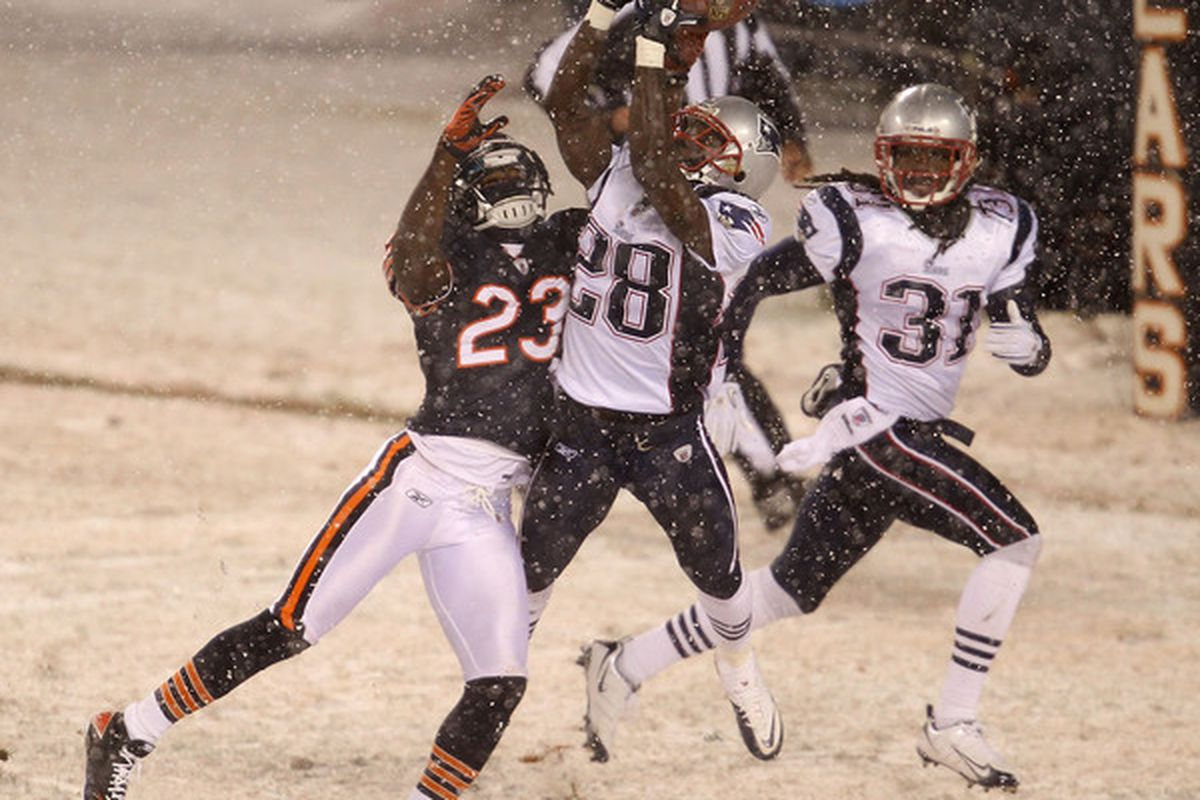 CHICAGO - DECEMBER 12: Darius Butler #28 of the New England Patriots breaks up a pass intended for Devin Hester of the Chicago Bears.