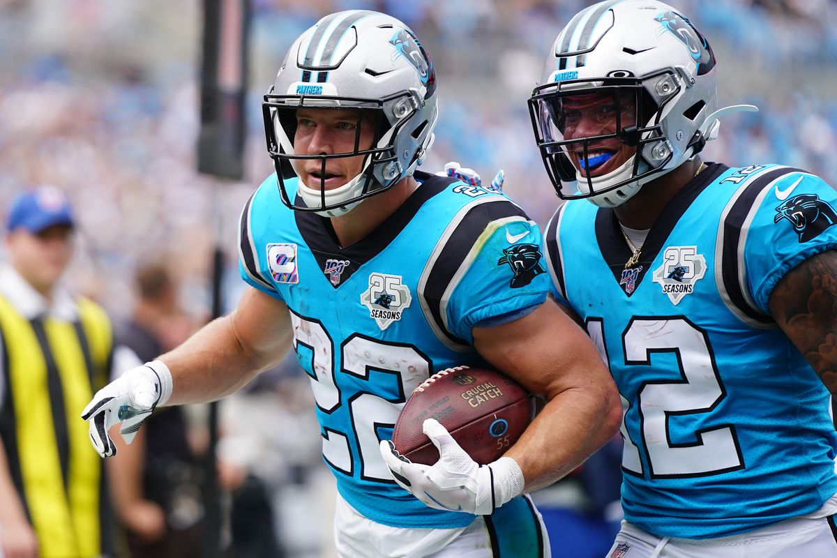 Christian McCaffrey #22 of the Carolina Panthers and D.J. Moore #12 of the Carolina Panthers during the first half of their game against the Jacksonville Jaguars at Bank of America Stadium on October 06, 2019 in Charlotte, North Carolina.