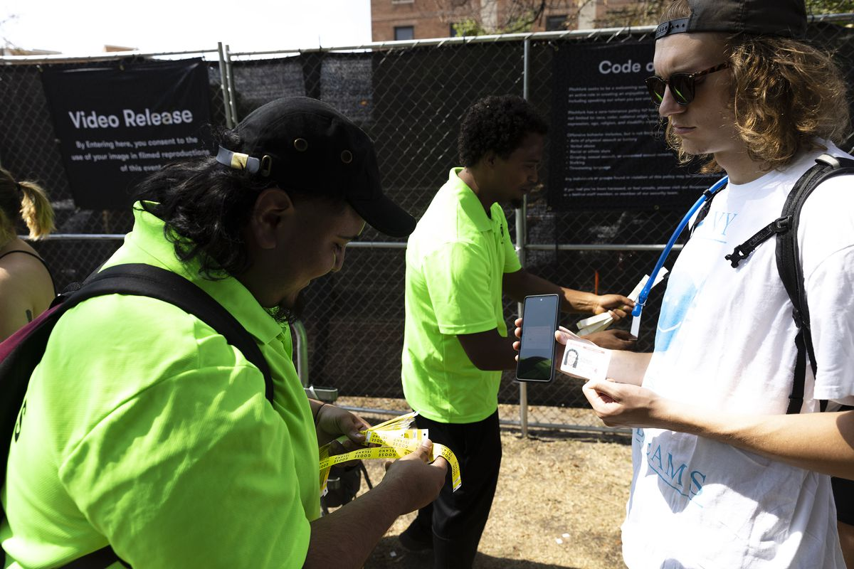 Security checks vaccination cards on Day 1 of the Pitchfork Music Festival on Friday.