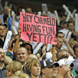 Fans sign to Denver's Carmelo Anthony as the Utah Jazz defeat the Denver Nuggets 105-93 as they play in game 3 of the first round of the NBA basketball playoffs.