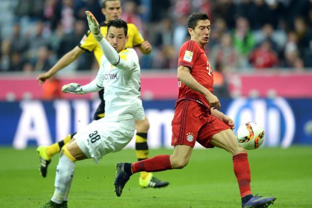 Bürki fails to get near the ball as Lewandowski walks it home
