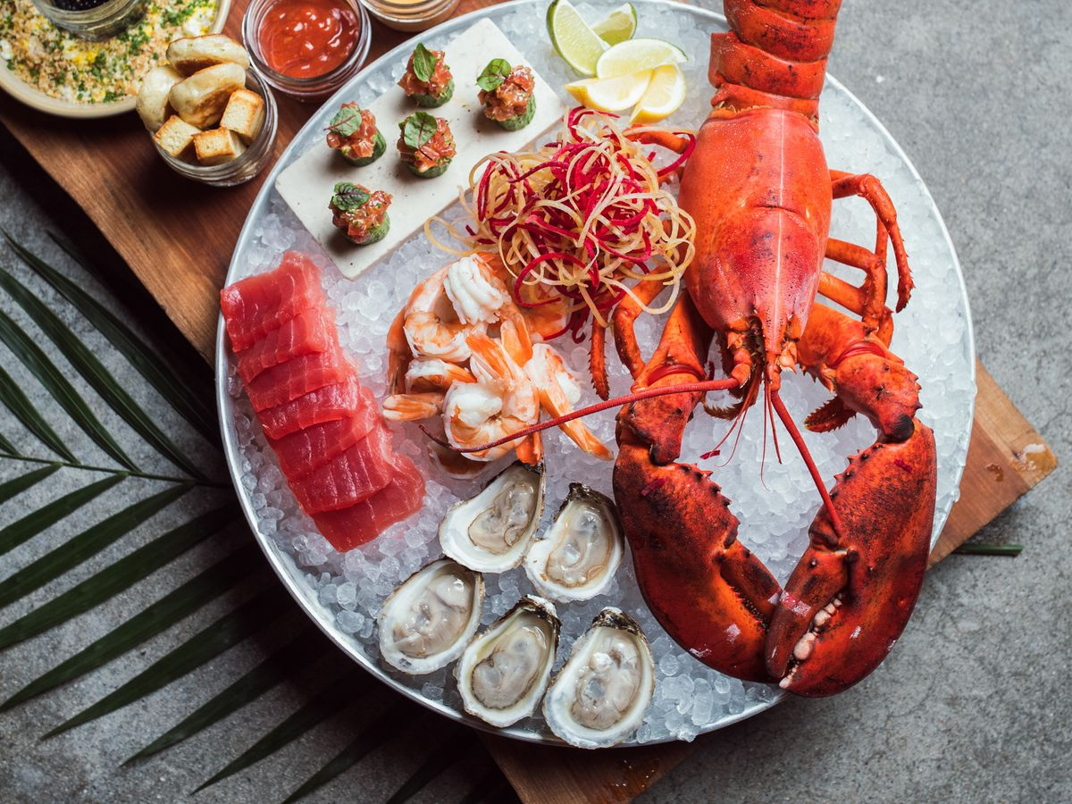 A seafood tray with oysters and lobster.