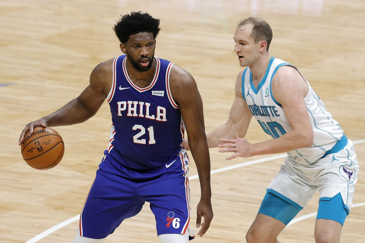 Joel Embiid of the Philadelphia 76ers posts up against Cody Zeller of the Charlotte Hornets during the second quarter of their game against the Charlotte Hornets at Spectrum Center on February 03, 2021 in Charlotte, North Carolina.