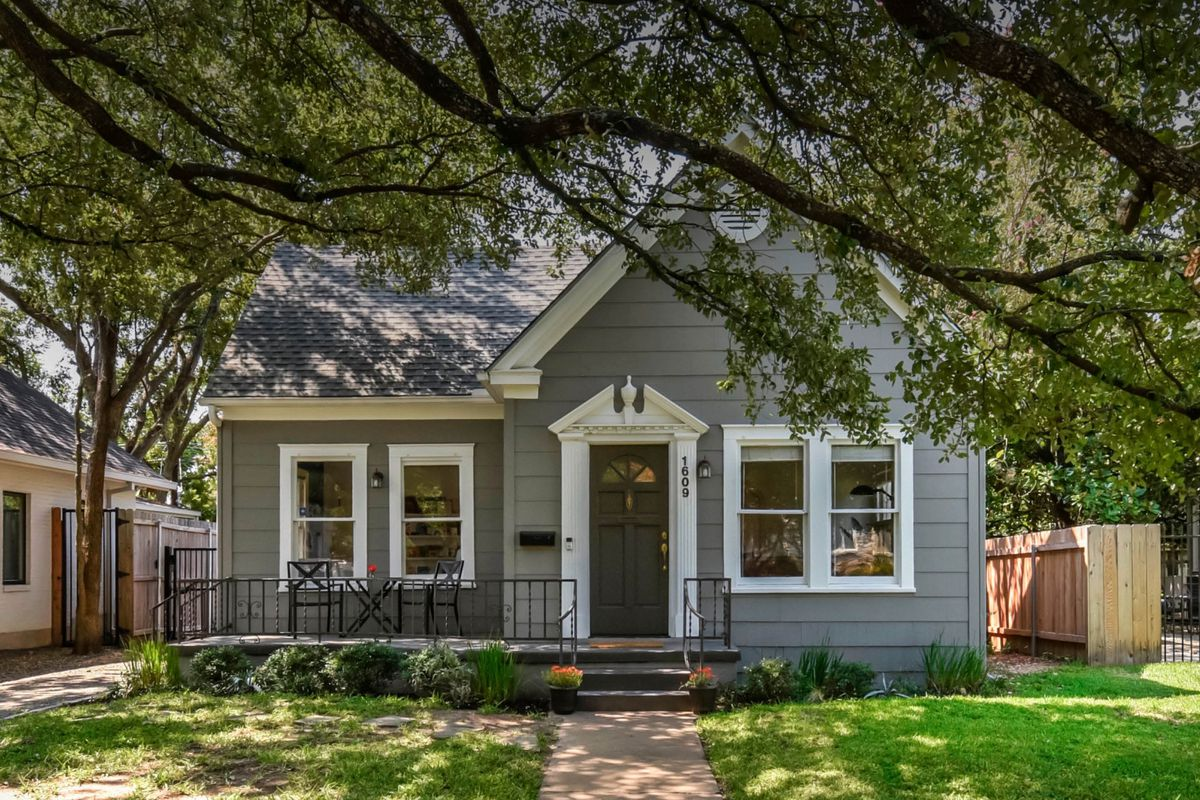 1938 gray wood-frame home with white trim