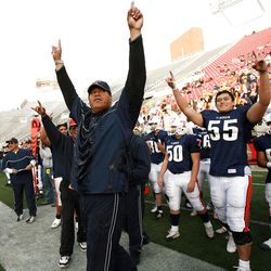 Timpview's Head Coach Louis Wong raises his arms in victory after Timpview and Highland met in the 4A State Football Championship game at Rice Eccles Stadium at the University of Utah November 17, 2006.