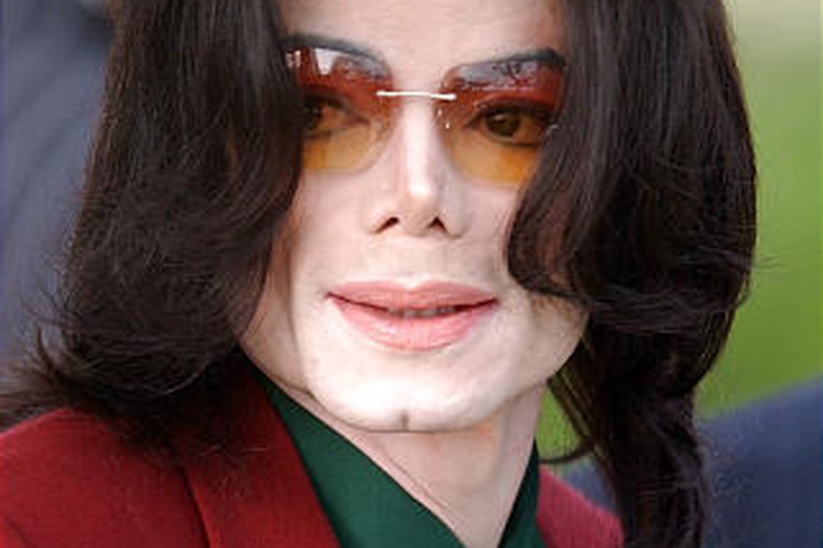 In this March 17, 2005 file photo, pop star Michael Jackson arrives at the Santa Barbara County Courthouse in Santa Maria, Calif.