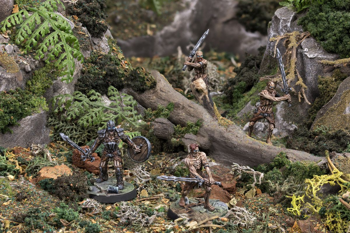 A group of Drahgr from the Elder Scrolls miniatures game push through a mountain p[ass in an early piece of key art from Modiphius Entertainment.