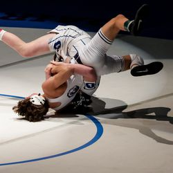 Corner Canyon's Tyler Vivanco, left, beats Pleasant Grove's Jacob Carson, right, in the 113-pound finals match at the 6A wrestling state championship at Corner Canyon High School in Draper on Friday, Feb. 19, 2021.
