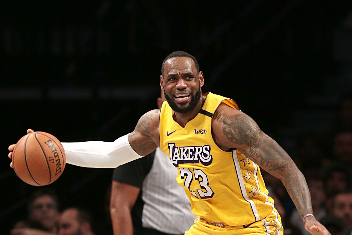 Los Angeles Lakers forward LeBron James grabs the ball during the second half against the Brooklyn Nets at Barclays Center.