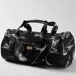 "<a href=""http://www.llbean.com/llb/shop/67796?feat=505944-GN3&attrValue_0=True%20Black""> LL Bean Signature Downeaster Sport canvas bag</a>, $39.99 llbean.com"