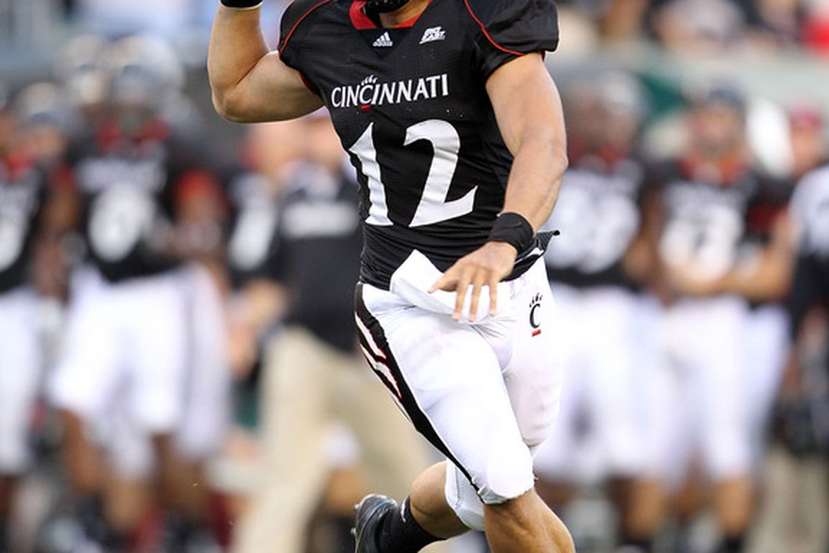 CINCINNATI - SEPTEMBER 25:  Zach Collaros #12 of  the Cincinnati Bearcats runs with the ball during the game against the Oklahoma Sooners at Paul Brown Stadium on September 25 2010 in Cincinnati Ohio.  (Photo by Andy Lyons/Getty Images)