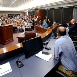 """Utah County residents pack into the Utah County Commision chambers in Provo on Wednesday, July 15, 2020 in Provo, to voice their opinions on state mandate that students in grades K-12 wear masks in schools. The commission was scheduled to vote on a letter asking Ralph Clegg, executive director of the Utah County Health Department, to give Utah County """"compassionate exemptions"""" to Gov. Gary Herbert's mandate. However, the meeting was cut short after Tanner Ainge, the commission's chairman, made a motion to continue the meeting at a later date, saying it violated several public health directives issued by the state and county. The motion to reschedule passed 2-1, bringing boos from protesters."""