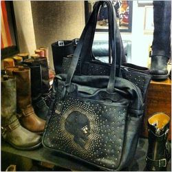 There are shoes, yes, but also skulls. The skull-stup zip shoulder bag is $448. Photos: Racked Chicago