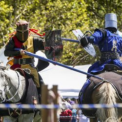 """Josh Avery, left, breaks his lance on Edwin Brazzero's shield during a jousting competition during the Utah Renaissance Faire at Thanksgiving Point's Electric Park in Lehi on Friday, Aug. 23, 2019. Avery travels the country jousting and has been featured on several shows, including the Amazon series """"Tilt."""""""