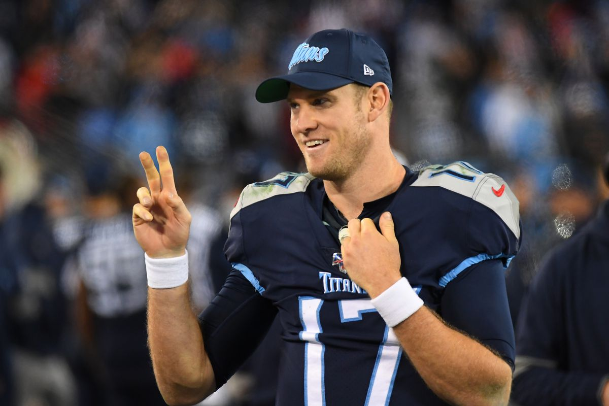 Tennessee Titans quarterback Ryan Tannehill salutes to fans late in the fourth quarter against the Jacksonville Jaguars at Nissan Stadium.