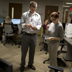 Dr. Ryan Taylor, left, a first-year resident from Chicago, and Ninah Clegg, a third-year medical student from Marian University, consult paperwork before seeing a patient during hospital rounds Thursday, April 28, 2016, at Franciscan St. Francis Hospital in Indianapolis.
