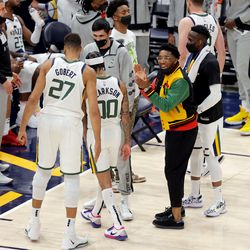 Utah Jazz guard Donovan Mitchell (45) claps during a timeout as the Utah Jazz and the Memphis Grizzlies play in game one of their NBA playoff series at Vivint Arena in Salt Lake City on Sunday, May 23, 2021.