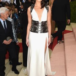 Emma Stone wears a Prada gown.