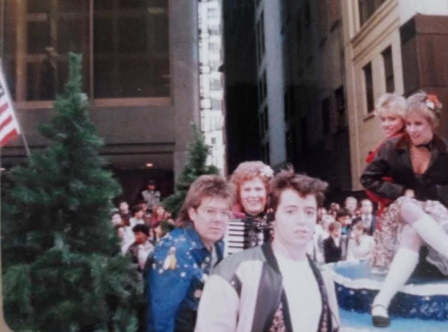 """Vlasta Krsek and her accordion with director John Hughes and Matthew Broderick during filming in downtown Chicago of """"Ferris Bueller's Day Off."""""""