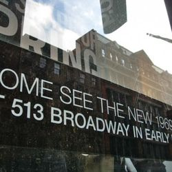The Gap's new home at 513 Broadway is reflected in the windows of the Gap's current home.
