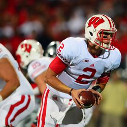 Joel Stave goes back to hand the ball off.