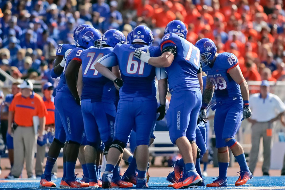 BOISE, ID - OCTOBER 01:  The Boise State Broncos huddle during the game against the Nevada Wolf Pack at Bronco Stadium on October 1, 2011 in Boise, Idaho.  (Photo by Otto Kitsinger III/Getty Images)