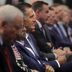 Sen. Mitt Romney listens as Vice President Mike Pence speaks at Merit Medical in South Jordan on Thursday, Aug. 22, 2019.