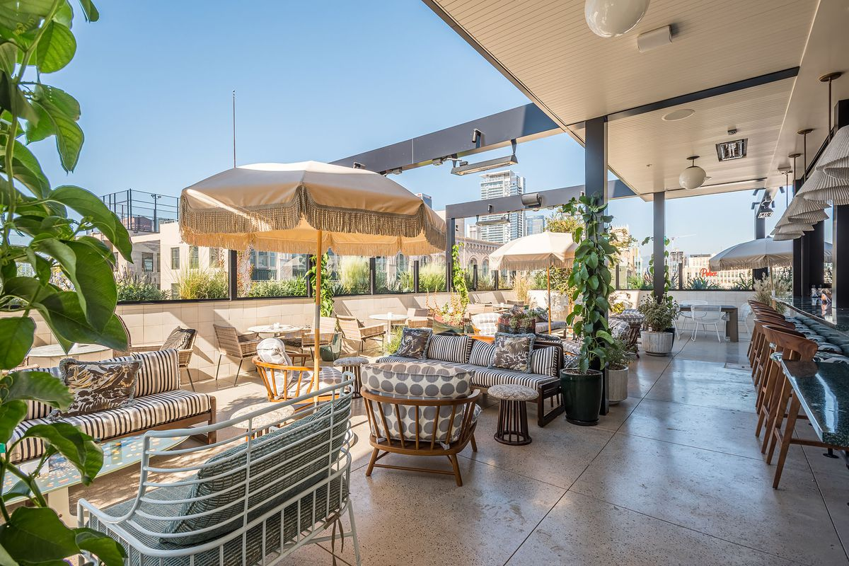 A variety of comfortable rooftop chairs at an open air bar at Pilot in Downtown Los Angeles